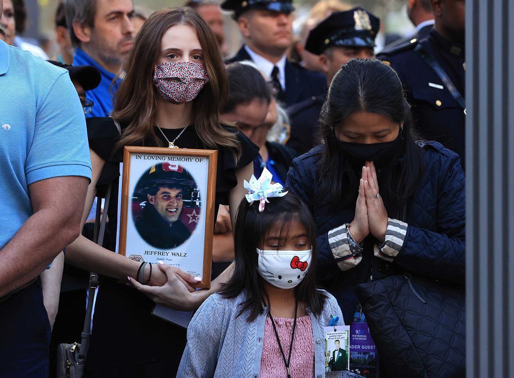 Durante a cerimónia, foram ditos os nomes das 2.977 vítimas do 11 setembro. Foto: Chip Somodevilla/EPA