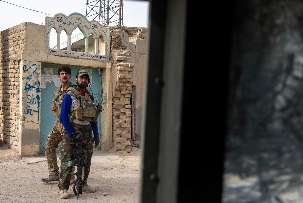 Membros das Forças Especiais no Afeganistão descansam durante combates ferozes com os Taliban. Foto: Danish Siddiqui/Reuters