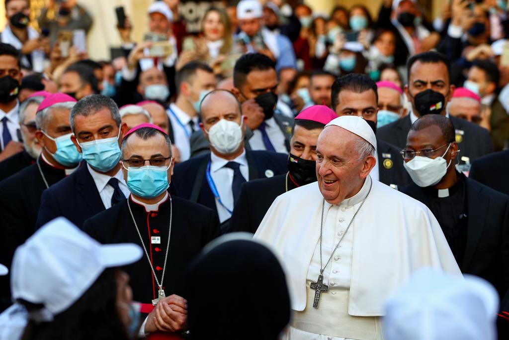 O Papa Francisco com cristãos iraquianos. Foto: Ahmed Jadallah/Reuters